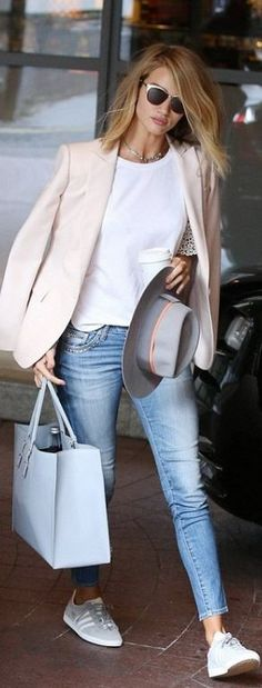 Who made Rosie Huntington-Whiteley's jewelry, cat sunglasses, blue skinny jeans, white lace top, pink blazer, sneakers, gray hat, and sneakers?