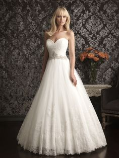 This romantic ballgown combines soft tulle and delicate lace beautifully. The strapless, fitted bodice features lace, a sweetheart neckline and Swarovski crystal detail at the natural waistline. Allure 9014