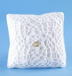 A gift idea for brides-to-be; create a gorgeous and heartfelt keepsake. A  crocheted Ring Bearer's pillow cover (Lion Brand® Pattern #: 80206AD).