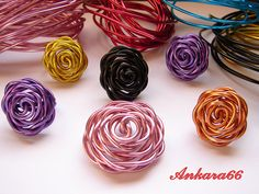 Wire rose rings. Could do with dollar store floral wire? Must try this soon...
