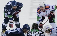 Ovechkin and Kovalchuk line-up during a face-off.