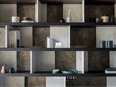 Tables, bookshelf, lamps, and accessories in natural stone by Salvatori Bookcase Storage, Bookshelves, Shelving, Rack Design, Beautiful Living Rooms, Cabinet Design, Display Shelves, Apartment Living, Eames