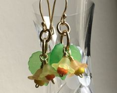 Items similar to Jonquilles Earrings, Daffodil Earrings for St Davids Day or Mothers Day on Etsy Daffodil Color, Daffodil Flower, Statement Earrings, Dangle Earrings, Lucite Flower Earrings, Saint David's Day, Parts Of A Flower, Organza Gift Bags, Bead Caps