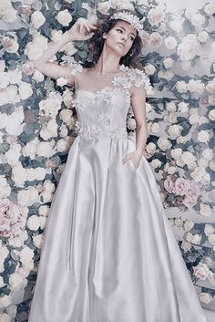A touch of flowers on lace and satin for the most romantic of wedding dresses.