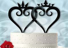 Simple  King and Queen Kingdom Hearts Inspired Wedding Cake. Wonder if they can make a small one to put in for Kiki too
