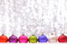 Christmas baubles with illuminated background Royalty Free Stock Photo >700