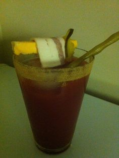 Created By Chef Tom Hodgins: This Is From About A Year Ago, A Shot Of Beer, 2Oz Vodka, Celary Salt For Rimmer Garnish With Pickled Bean Spear, Cheese With A Sandwich Slice (Dill Pickle)  and Yupp Thats A Raw Piece Of Bacon