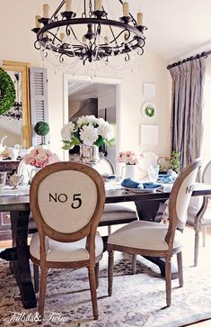 Eclectic Home Tour of Tidbits and Twine - love the numbered dining room chairs eclecticallyvintage.com