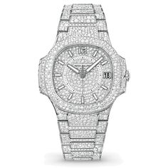 A white gold fully pavéd model of the Patek Philippe Nautilus for women, Ref. 7021, set with approximately 2,328 diamonds. Discover what in the year of its 40th anniversary makes Patek Philippe's Nautilus watches such an iconic style for men: http://www.thejewelleryeditor.com/watches/article/patek-phillipe-nautilus/ #luxury