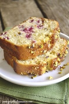 Raspberry pistachio loaf - Light, springy and moist raspberry pistachio loaf served with some tea and cupcakes for a perfect Sunday tea party. #loaf #pistachio #raspberry www.sprinkleofcinnamon.com
