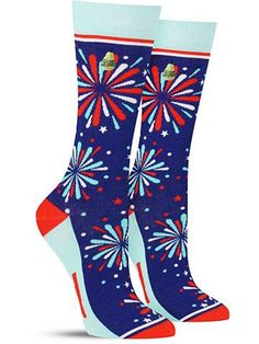 """Well aren't you a little firecracker! Show off your American pride with these fun and patriotic fireworks socks in red, white and blue! You'll find the words """"DYNA"""" and """"MITE"""" hidden on the bottom of"""
