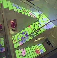 In the Louis Vuitton store in Hong Kong, architect Peter Marino developed an interactive staircase. The steps enclose a plasma screen that plays technicolour tricks on the eye.