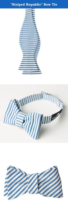"""""""Striped Republic"""" Bow Tie. """"Men's fashion in the 1930's exuded power and refinement. Tailor your own modern-day style to bring back the essence with a Stripe Republic Bow Tie. Displaying the most essential highlights to your suits with authentic fabrics from 1930's France. Made of classic viscose rayon fabric imprinted with blue stripe patterns empowering you to impress and delight."""" No. Produced   4 Due to the vintage quality of our clothing there were only a limited amount produced for..."""