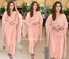 Kriti Sanon was snapped at Mumbai airport recently dressed in a casual peach kurta palazzo suit. She skipped the jewelry and finished off her look with subtle makeup! Casual Indian Fashion, India Fashion, Indian Gowns Dresses, Indian Fashion Dresses, Indian Attire, Indian Wear, Wedding Dresses For Girls, Girls Dresses, Kriti Sanon Saree