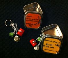 monopoly card tins and keychains made with monopoly pieces