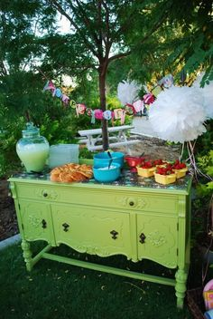 How cute would a brightly colored buffet be ..i wish we could bring my buffet perfect size for liquados i need to paint it anyway abd always fun to have some outside intersting furniture at party.my neibor could bring it.