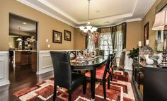 This formal dining room from @Lennar Charlotte features a great window and a tray ceiling