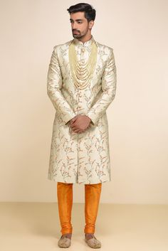 Oshnaar Grey All Over Floral Embroidered Sherwani With Orange Chudidar. #flyrobe #groom #groomwear #groomsherwani #sherwani #flyrobe #wedding #designersherwani