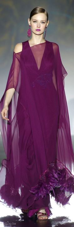 Patricia Avendaño 2016 - gorgeous plum gown is light as a feather, quite literally, as the bottom is edged in dyed-to-match feathers and beads.