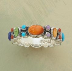 Lapis lazuli, turquoise, coral, spiny oyster shell, sugilite, etc.  So much color!  I really really enjoy this ring.