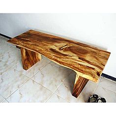@Overstock - Add some novelty décor to your home with a hand-carved wooden bench. This hand-crafted bench is made from monkey pod wood and created in Thailand. This one-of-a-kind furniture stands 48 by 17 by 18. The benches are each hand carved.http://www.overstock.com/Worldstock-Fair-Trade/Hand-carved-Wooden-Natural-Edge-Bench-Thailand/5226481/product.html?CID=214117 $313.19