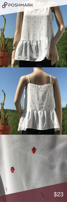 """NWT Dalia Sizzling Summer Sweet Top. SIZE M. Cute! NWT Dalia Sizzling Summer Sweet Top. SIZE M. Cute!  38"""" bust, 25"""" length. Sooo cute with peplum and a tiny rosebud (or strawberry?) print on white. Adjustable straps. The possibilities are endless! Dalia Tops Tank Tops"""