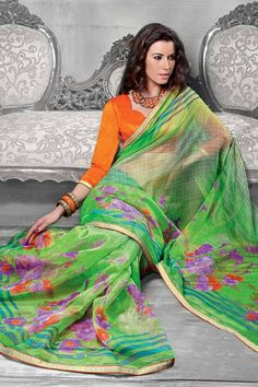 Green Super Net Saree With Dupion Blouse Price: £29 Green,Super Net saree with orange, Dupion blouse.  Embellished with Printed Work. Saree with Fancy Pallu and Lace Border ,U Neck Blouse, Quarter Sleeve Blouse.  It comes with unstitch blouse, it can be stitched to 34,36,38,40 sizes.        Andaaz Fashion is the most popular designer wear online ethnic shop brands in UK.  http://www.andaazfashion.co.uk/womens/sarees/green-net-saree-with-dupion-blouse-dmv9069.html#