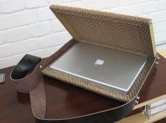 Laptop case Use cardboard to fashion together a case to hold your laptop....