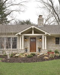 break up a boring rectangle ranch house roof line for curb appeal. Love the birch tree and easy to care for landscaping