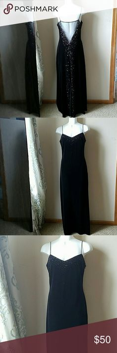 Gorgeous Black Velvet Formal Dress Excellent used condition. Looks like new. Beautiful sparkly detail on the back, with a mesh-like tail Dave and Johnny Dresses