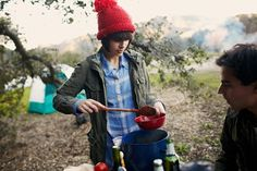 Spring Summer- Cooking and dishing out cmaping meals- Great colours and composition of the main figure and props.