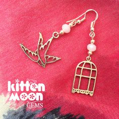 A pretty mismatched pair of earrings featuring a bird cage and a bird of the wing. Available in my Etsy store now.