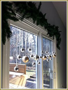 Same blogger as piano display~~~~simple garland and bulbs hanging!