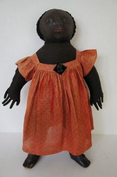 Large painted face antique black cloth doll very strong presence.