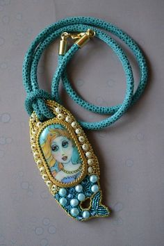 Beautiful beaded embroidery. Painted mermaid cabachon by Dianne McGhee of GroovyGlass.com beaded by Kinga Nichols of CrimsonFrog