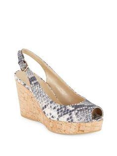 4bce3276d3 STUART WEITZMAN Peep-Toe Leather Wedge Sandals. #stuartweitzman #shoes # sandals