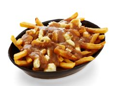 Poutine from FoodNetwork.com... this looks like the type of thing that I can only justify eating once a year because it's so unhealthily delicious