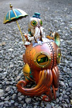 Little octopus riding his steampunk octo-robot <3
