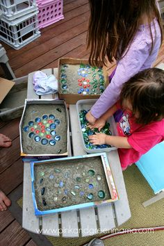 Kids Home Made Arts and Crafts by Pink and Green Mama: Stepping stones made of Quickcrete in cereal or pizza boxes. If desired, use wire coat hangers or purchased wire mesh for reinforcement.