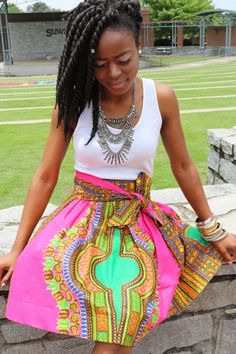 This Hot Pink High-Waist Dashiki print skirt is a perfect addition for Summer. Pair it with a high heel a fun night on the town, or rock it with a sexy sandal and a cotton tee for a more casual look.   Product Description  This skirt features a beautiful print made from 100% cotton. A comfortable waist band sitting at your high waist. Comes with as sash. Side seam pockets.  Sizes  XS: Waist 25-26 S: Waist 27-28 M: Waist 29-30 L: Waist 31-33 XL: Waist 34-36 2XL: Waist 37-39 3XL: Waist 40-42…