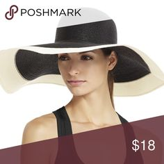 BCBG MAXAZRIA Two Tone Floppy Hat A sleek and classic hat for high-style with resort-ready appeal. Woven hat. Wide floppy brim. Two-tone detail. Has gotten a little indented on a trip, but still looks beautiful BCBGMaxAzria Accessories Hats
