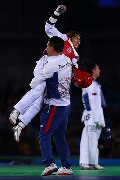 Sohui Kim of Korea celebrates with her coach after winning gold over Tijana…