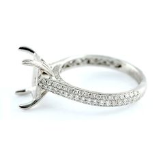 Classic Pave with Round Brilliants in Three Rows Diamond Engagement Ring Mounting. 18kt white gold semi-mount set with three rows of round brilliant diamonds in a slightly domed band.  .64ctw
