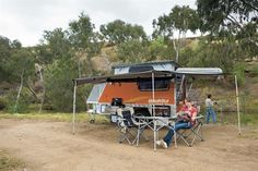 Woman camping with a camper trailer by Quokka Toy Hauler Van Camping, Camping World, Camping Gear, Camper Trailer Australia, Used Rvs, Quokka, Women Camping, Campers For Sale, Toy Hauler