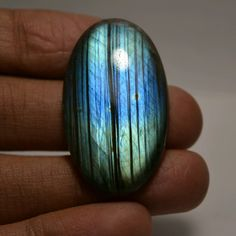 Labradorite oval cabochon.. Finest Quality.. Beautiful Blue Flash Cabochon..  41.15x23.95x6.1mm..48.8cts..  All Values In Near Approx..  Shipping:- All the parcels will be shipped within 3 days of purchase... ***FOR OTHER SHIPPING MODES, UPGRADES, OPTIONS, TERMS & CONDITION, SEE OUR SHOP ANNOUNCEMENT***   Payment:- We accept payment through PAYPAL only.  Return:- if you are not satisfied with our product, you may return your order within 14 days from the date of shipment received. The ite...