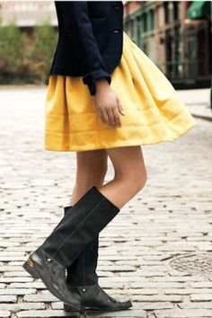 Equestrian boots take a full skirt from ladylike to sporty.
