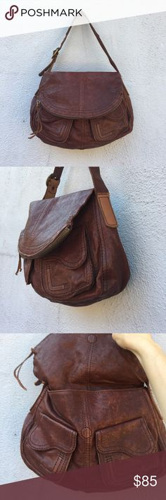 """Lucky Brand Hobo Stash Bag FlipTop Zipper Lambskin Lucky Brand Hobo Satchel Zipper 100% Lambskin Stash Bag. Short single strap (adjustable). 2 main compartments, one is a zipper enclosed larger portion that folds over the rest of the purse. Magnetic closure on all external pockets. Has some scratches on the back-- please see photos! A gorgeous brown color with brass fixtures. In great condition aside from the scratches. Measures approximately 14""""W x 10""""H x 3""""D with a 9"""" strap drop Lucky…"""