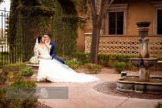 The newlywed bride and groom share a moment at Villa Siena in the Tuscan front gardens | Pure Touch Photography | villasiena.cc