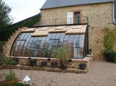 Greenhouse backed by a house Greenhouse of Yesteryear basileek serres Greenhouse Attached To House, Lean To Greenhouse, Greenhouse Plans, Greenhouse Gardening, Greenhouse House, Homemade Greenhouse, Cheap Greenhouse, Portable Greenhouse, Indoor Greenhouse