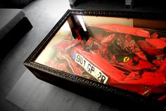 Fun example of a shadow box frame can be made into a coffee table as well as it shows how you can frame anything that is meaning to you.  Even if it is your wrecked Ferrari :)